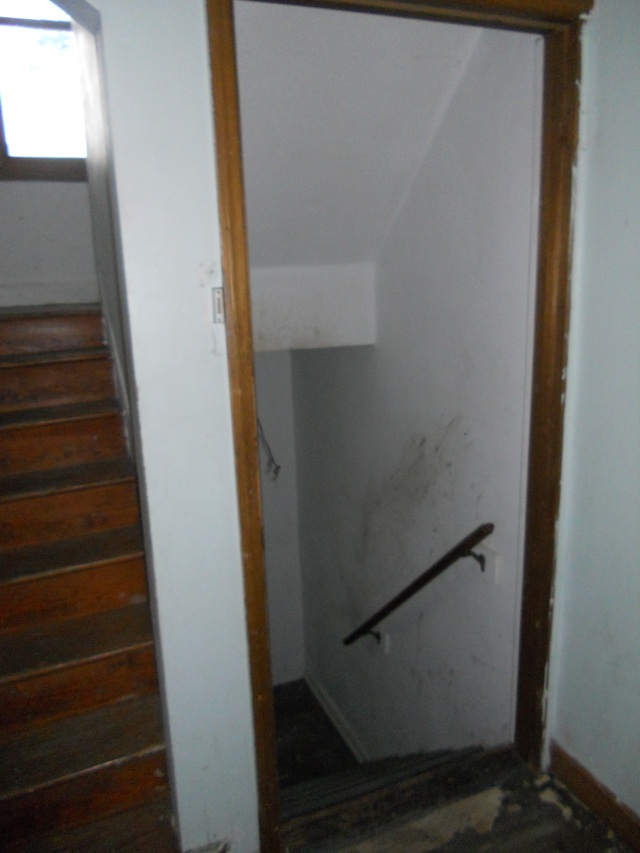 Upstairs on the left and downstairs to the basement on the right.