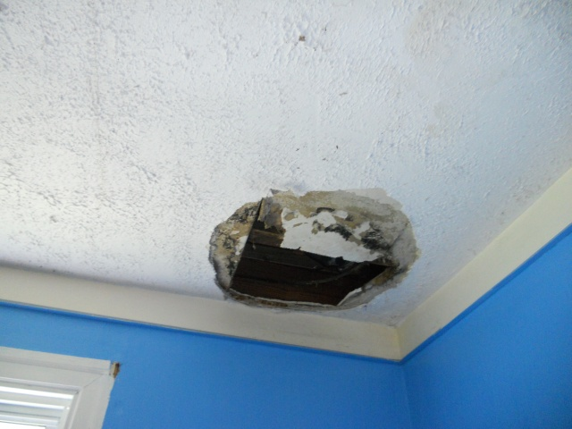 Ceiling hole from a water leak.